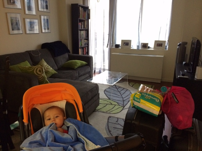 Baby in stroller in manhattan apartment