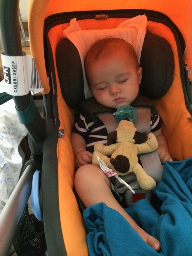 Baby in orange car seat