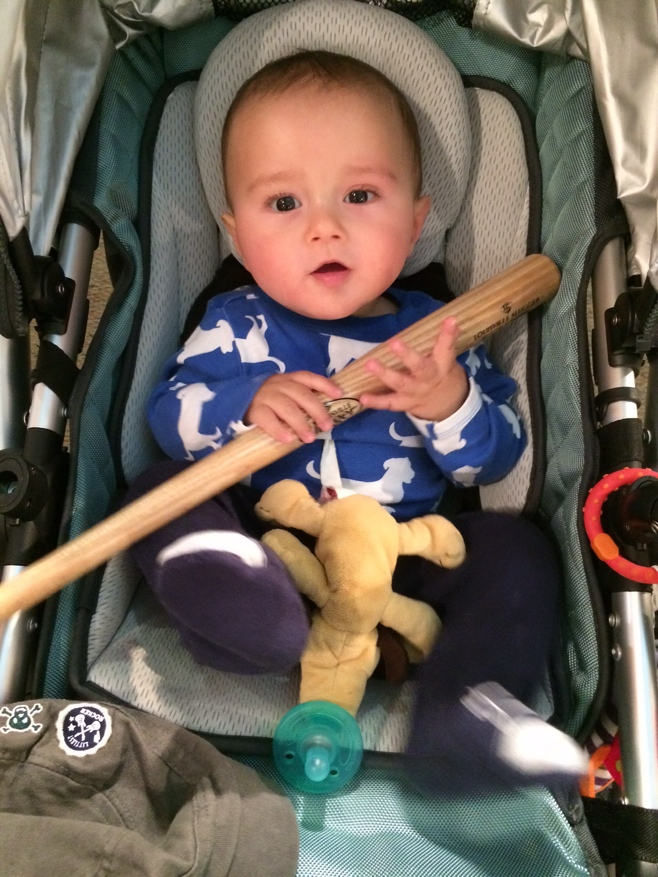 Baby with miniature baseball bat