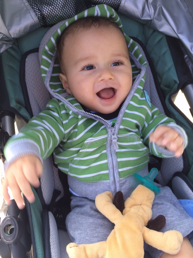 Baby laughing in stroller