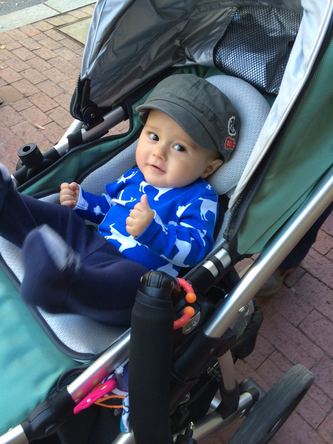 Baby in stroller giving thumbs up