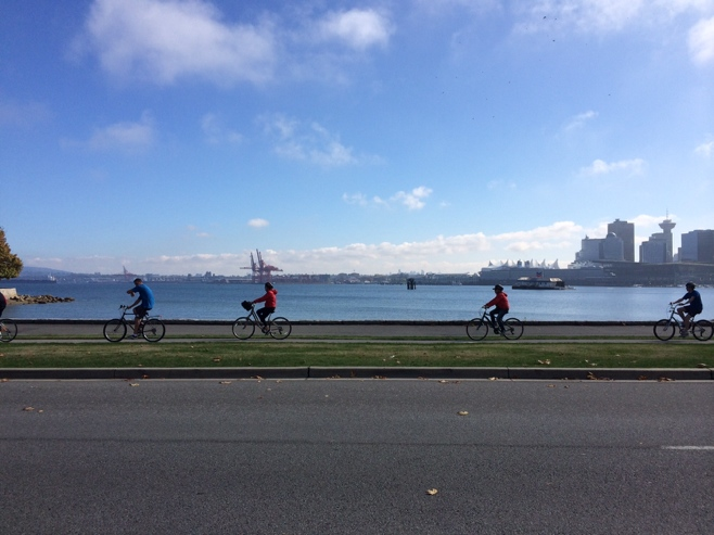 Bike riding along the sea wall in Stanley park