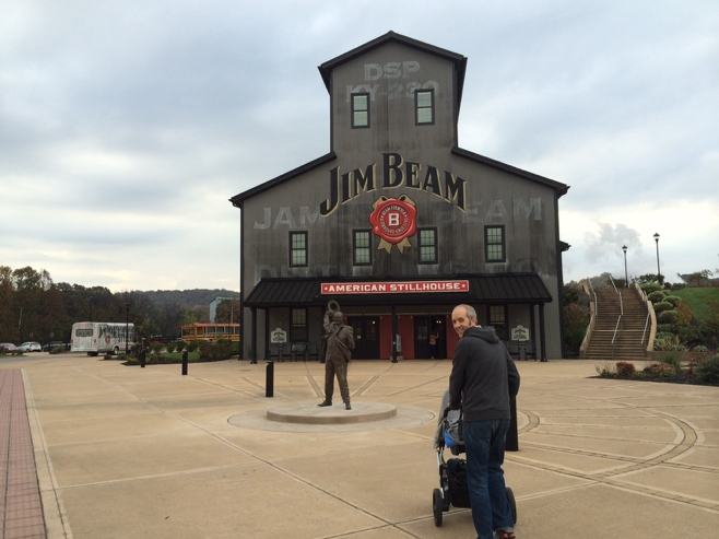 Man and stroller in front of Jim Beam center