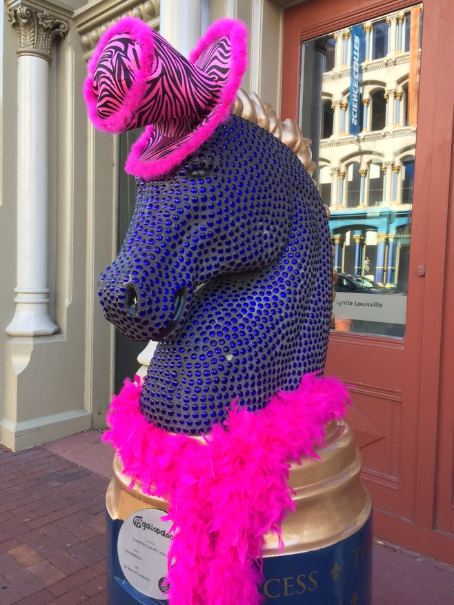 Horse statue with feather boa