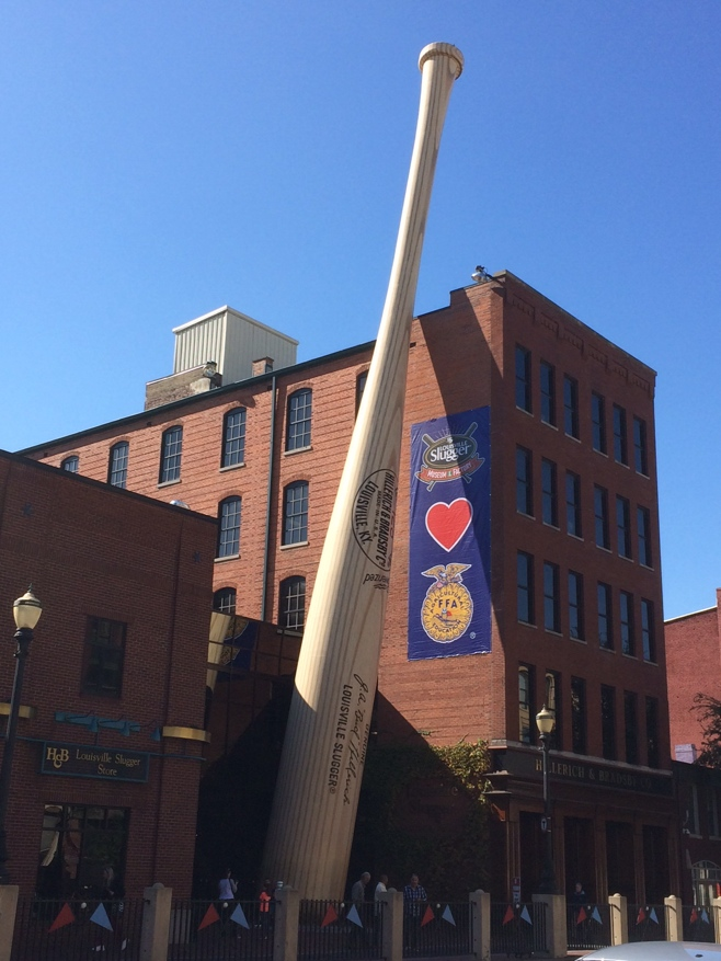 Large baseball bat on side of building