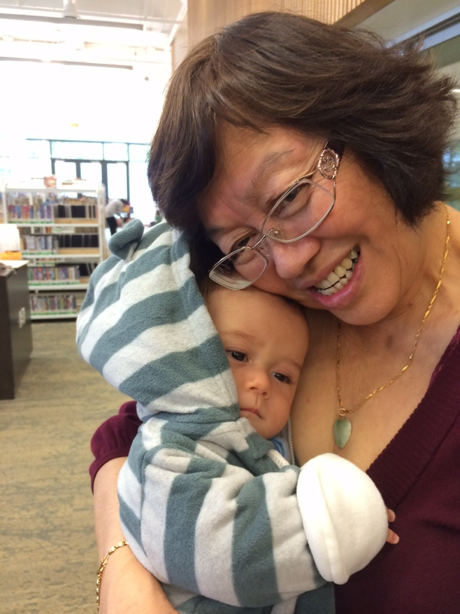 Grandma carrying baby in the library