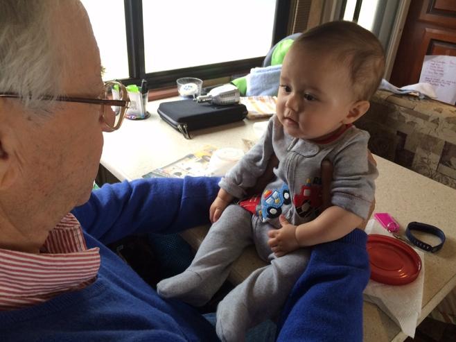 Baby and grandpa taking