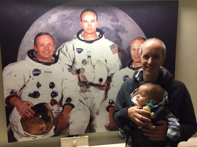 Baby and dad with astronauts