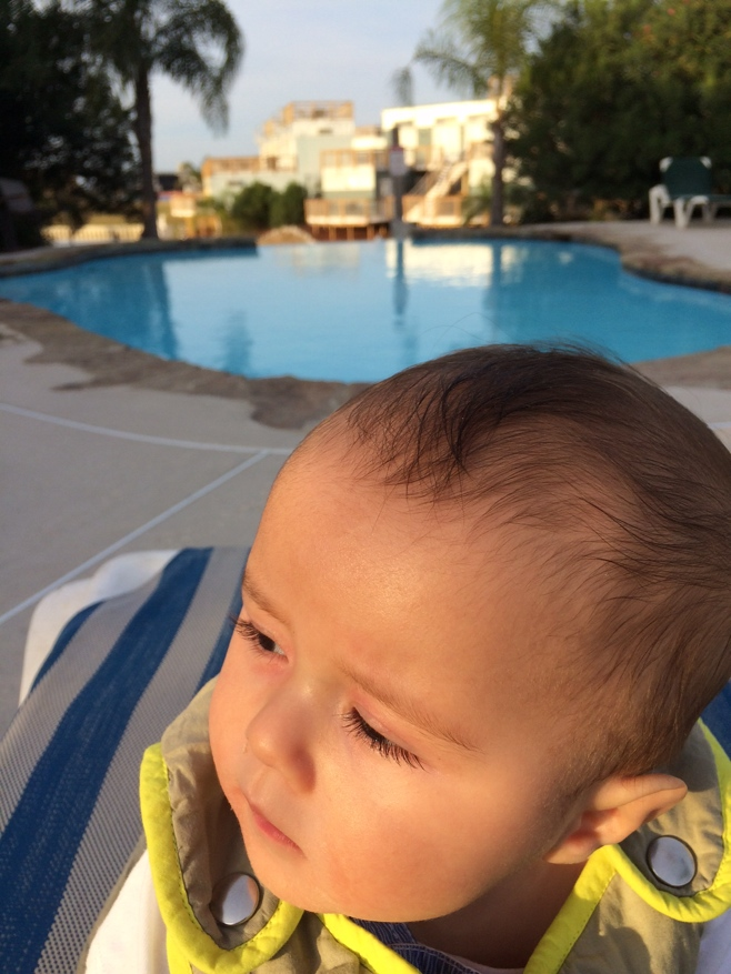 Baby by the pool