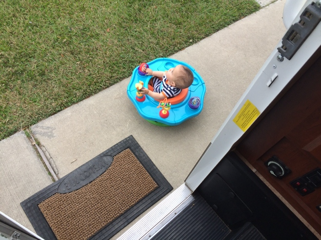 Baby in play seat outside RV