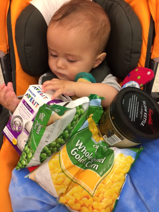 Baby with groceries in stroller