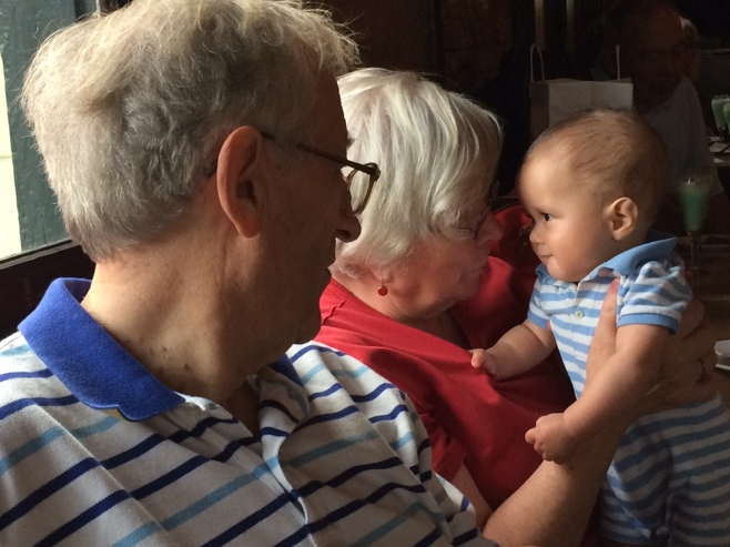 Baby with grandparents in pub