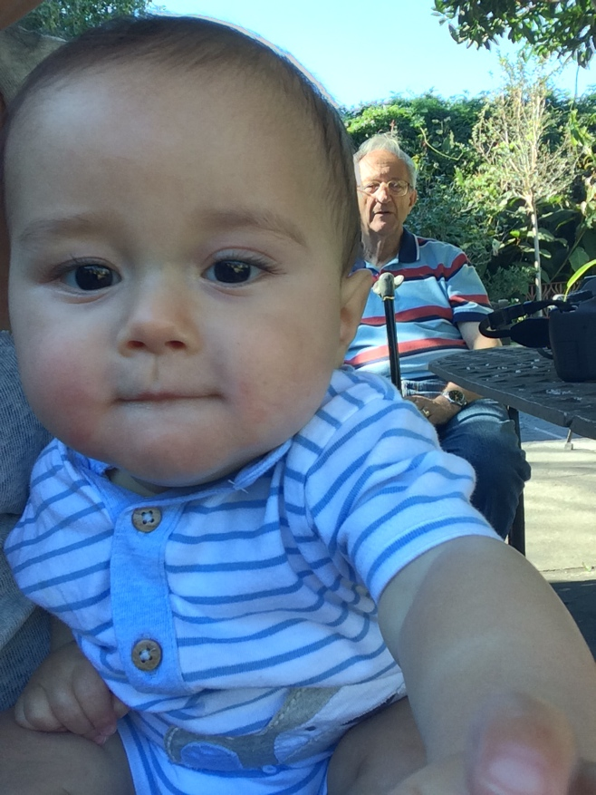 Baby and grandpa sitting