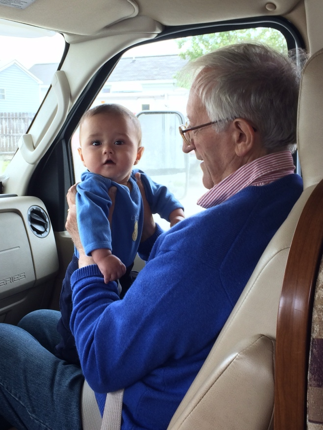 Baby being held by grandpa