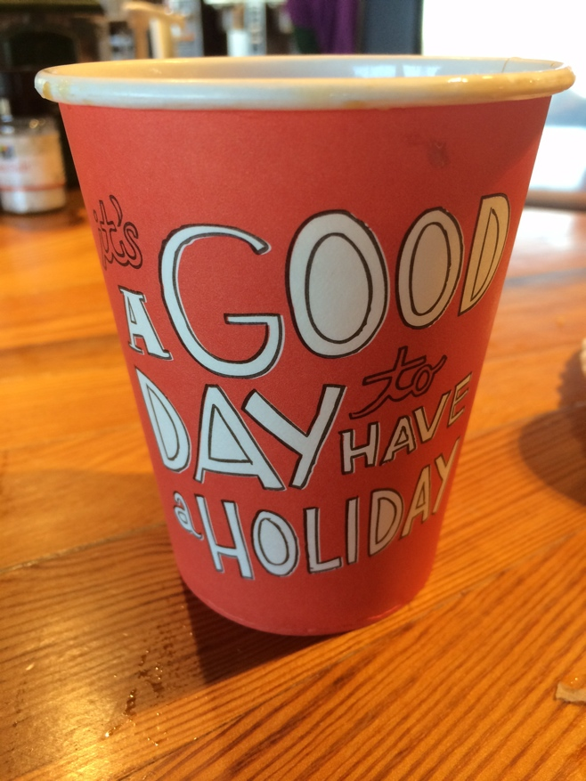 Cup that reads a good day to have a holiday