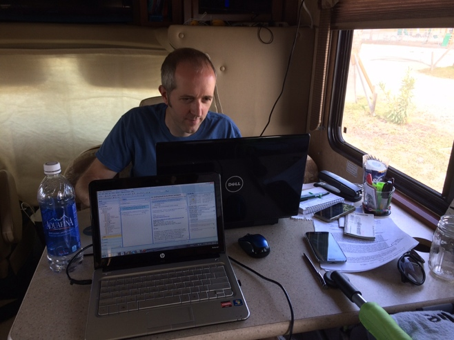 Man working on laptop in RV