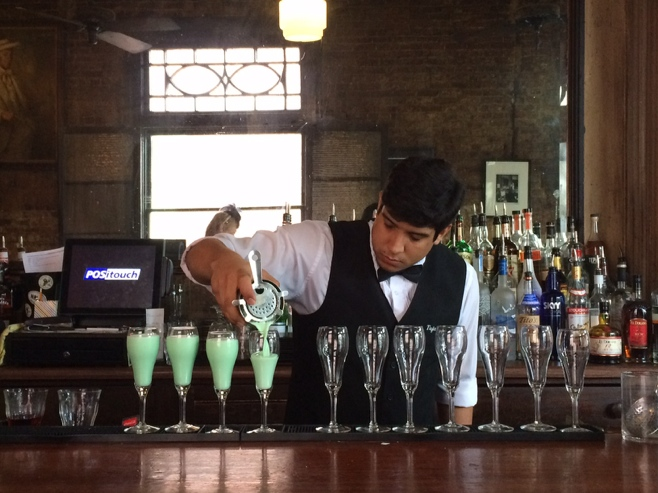Pouring grasshopper cocktails