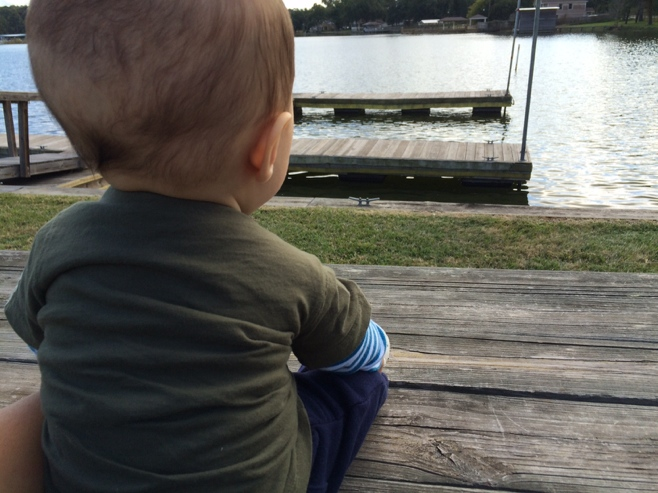 Baby sitting looking over lake Conroe