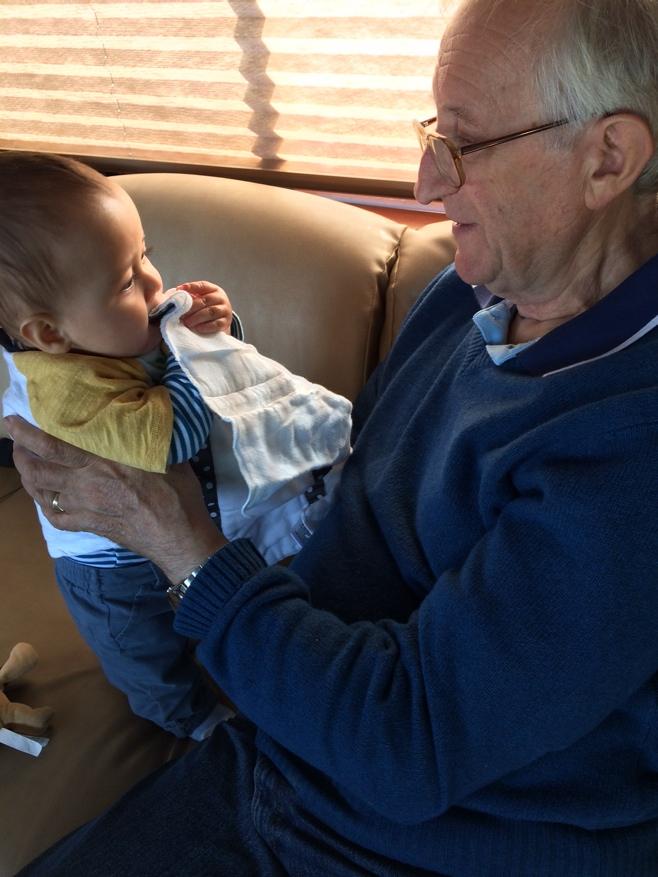 Grandpa holding baby in Walmart carpark