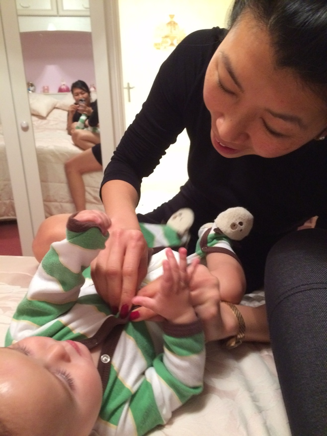 Aunty getting baby ready for bed