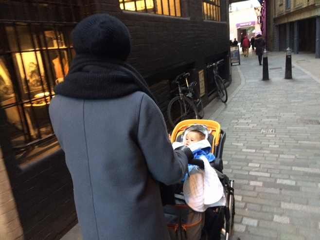 Aunty and baby walking streets of London