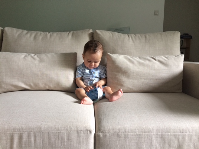 Baby on cream couch