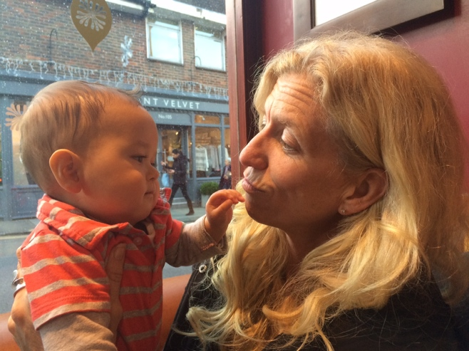 Baby with woman in cafe