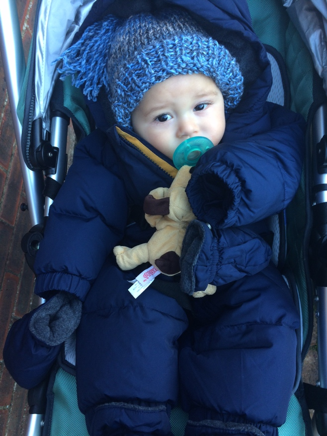 Baby in snow suit and wooly hat