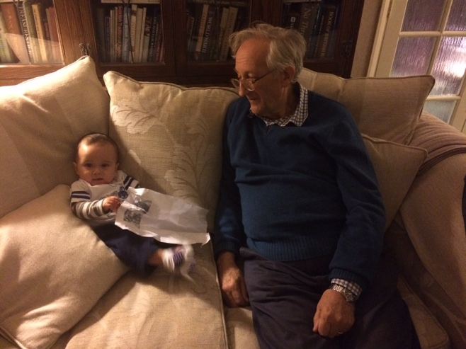 Baby with grandpa on couch
