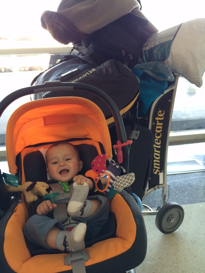 Baby in stroller with luggage