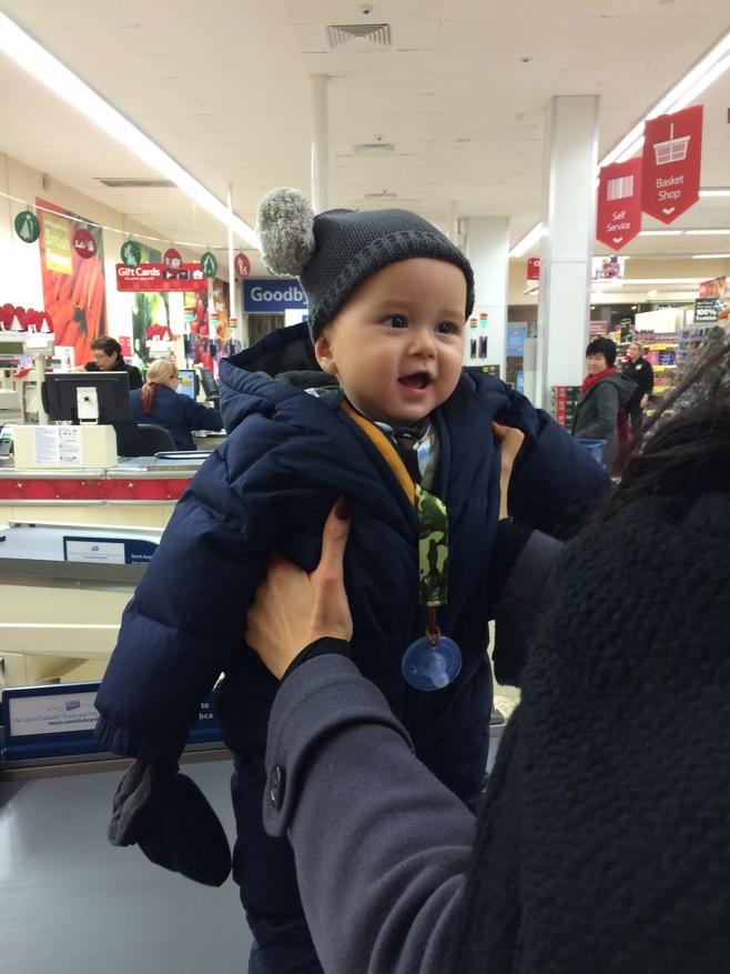 Baby standing in supermarket