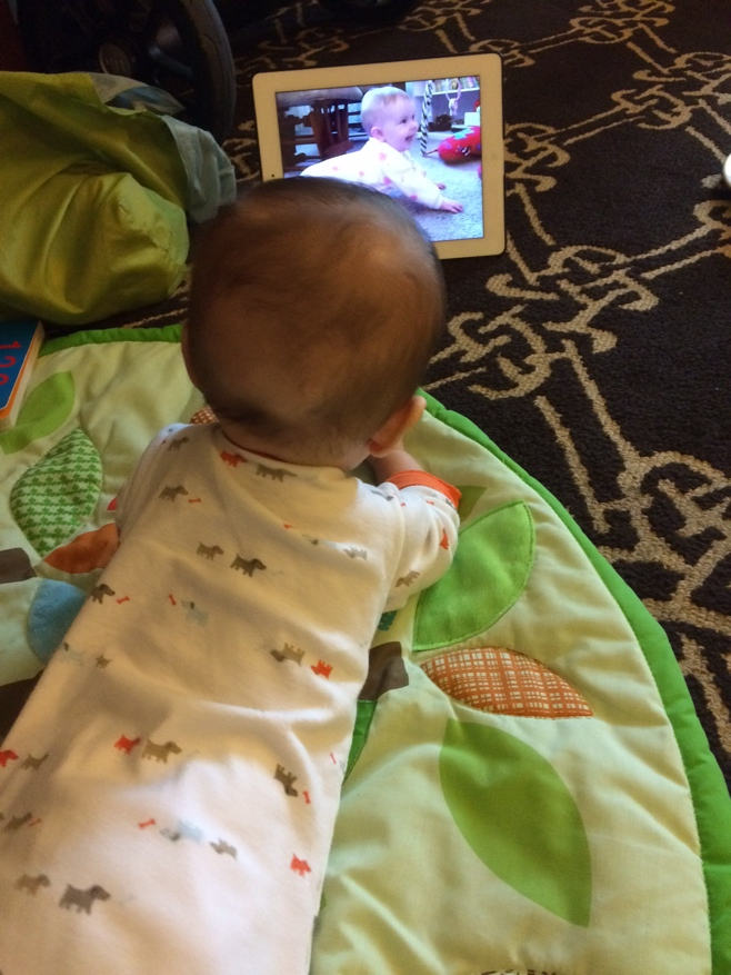 Baby watching babies crawl on iPad