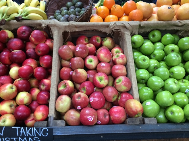 Boxes of red and green apples