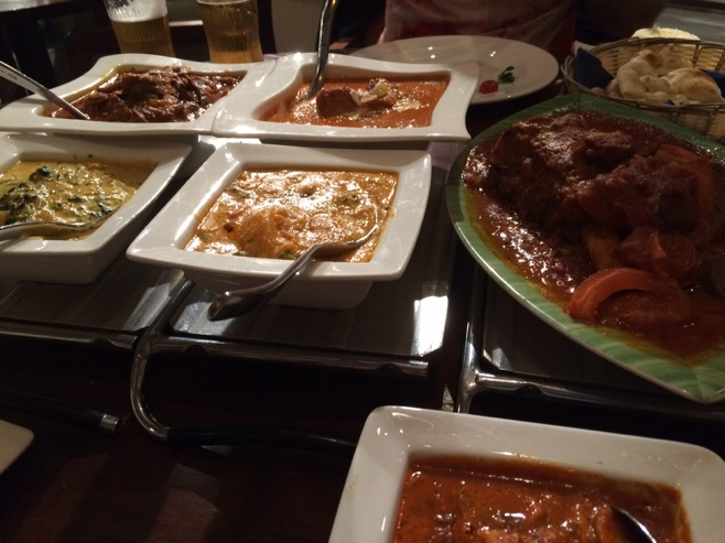 Curry dishes on table