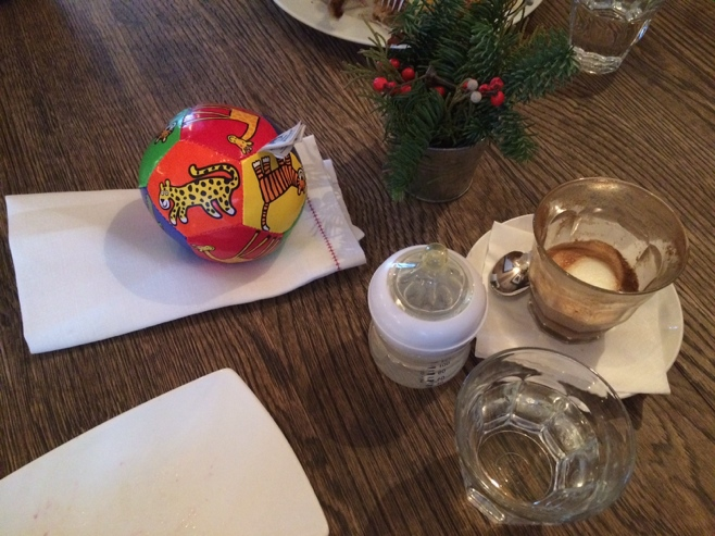 Coffee bottle and ball on a coffee table