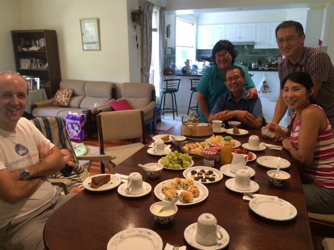 Family at table having afternoon tea