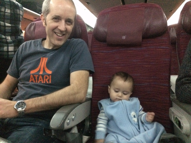 Baby and dad in airplane bulkhead row