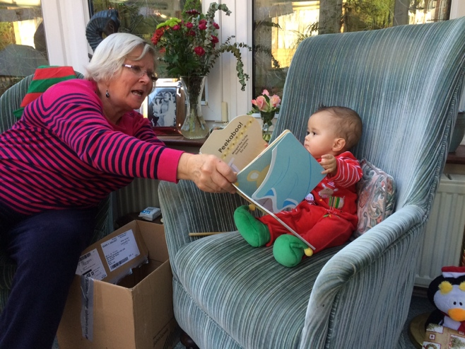 Baby and grandma with book