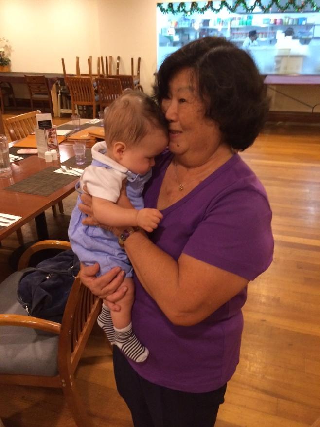 Baby cuddling great aunt