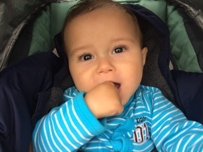 Baby in stroller smiling
