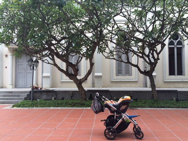 Baby in stroller infront of white church