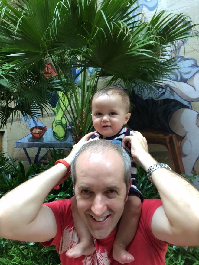 Baby on dad's shoulders