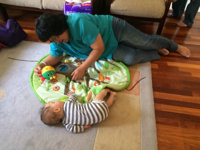 Baby rolling on play mat
