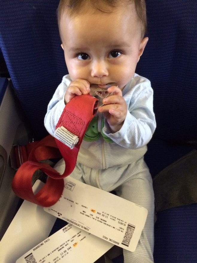 Baby holding baby seatbelt