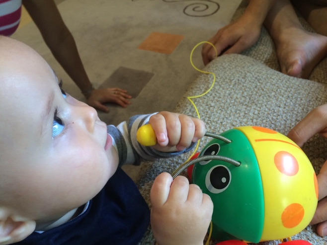 Baby with bug toy
