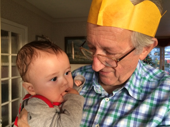 Baby and grandpa wearing Christmas crack hat