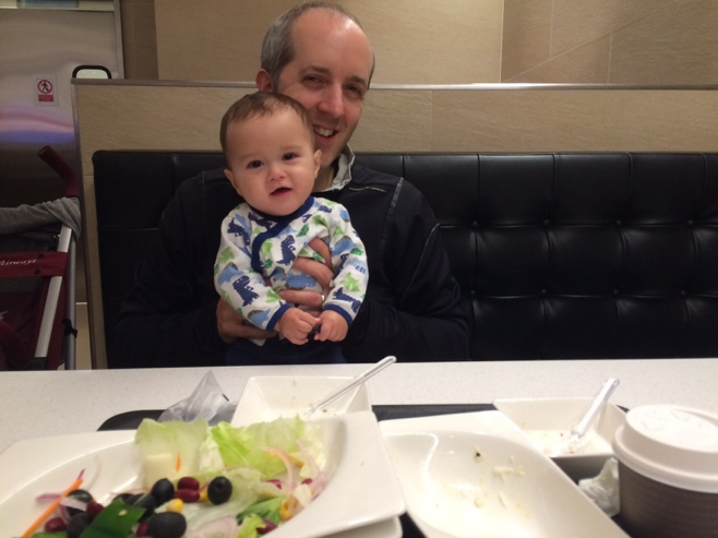 Man with baby dining in Marche
