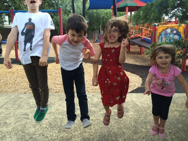 Four kids jumping