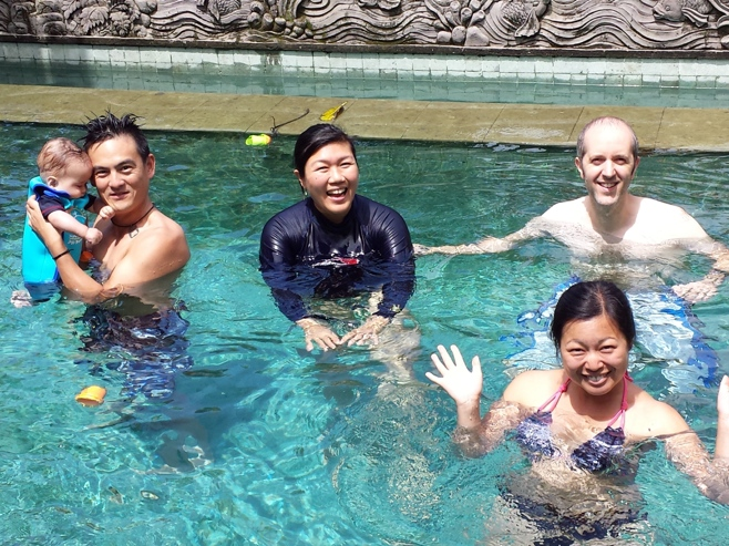 Four people and baby in the pool
