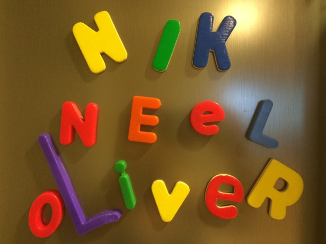 Three boys names on the fridge